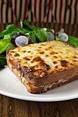 Croque Monsieur with Cheese on the Top on a White Plate