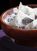 Handmade Tea Bags with Fruit, Flower and Berry Tea in a Wood Bowl