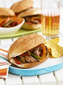 Flank Steak Sandwiches with Peppers; With Chips and Beer