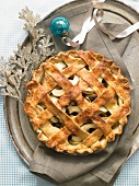 Whole Lattice Topped Apple Pie on a Tray with Blue Christmas Ornament