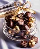 Various chocolate pralines with gold leaf