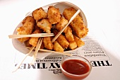 Fish & chips in newspaper with ketchup