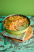 Macaroni cheese with pumpkin and spring onions