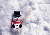 Ornamental snowman in snow