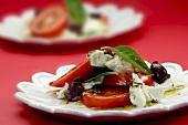 Caprese salad with tomatoes, mozzarella and basil