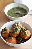 Icli kofte (stuffed bulgur dumplings, Turkey) with spinach and pesto