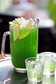 Green apple vodka in a glass jug