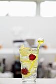 Vodka and lemonade with cherries