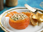 Fish salad in a smoked salmon basket