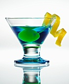 Blue Moon Martini with Yellow Cherry and Lemon Peel Garnish