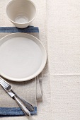 A beige coloured place setting