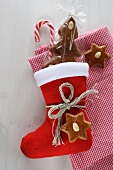 A Christmas stocking, candy canes, gingerbread and checked cloth