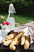 Puff pastry cheese sticks, a dip, radishes and homemade lemonade