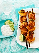 Spicy fish kebabs with onions and tzatziki
