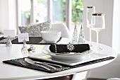 Elegant black and white place setting with silver ornaments