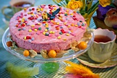 Raspberry mousse tart with coloured Smarties for Easter
