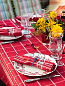 Table set with red cloth for crayfish party in garden