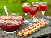 Sangria and potato and cheese pastries with caviar