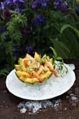 Avocado and prawn salad in hollowed-out musk melon