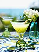 Kiwi smash (cocktail with vodka, lemon juice & kiwi juice)