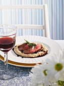 Steak on white bean puree with crema di balsamico