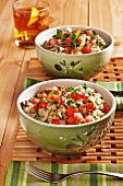 Two Bowls of Dirty Rice with Chopped Beef, Sausage, Tomatoes and Parsley