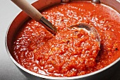 Pot of Basic Tomato Sauce with Ladle