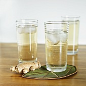Glasses of Homemade Ginger Ale with Fresh Ginger Root