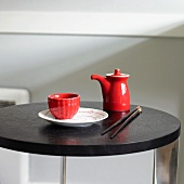 Red and White Asian Dishware on a Table with Chopsticks