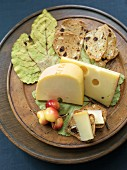 Semi Soft Cheeses with Crackers on a Wooden Dish