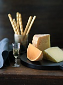 Three Hard Cheeses, Mimolette, Gran Queso and Manchego; Glass of Sweet Dessert Wine; Bread Sticks