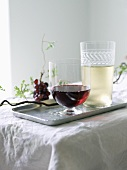 Two Glasses of Wine; A Glass of Red and a Glass of White; On a Silver Tray