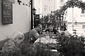 Guests eating on the terrace of an Italian restaurant