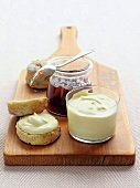 Scones with clotted cream and a jar of jam