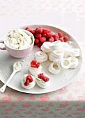 Meringue with nougat mascarpone and raspberries