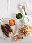 Minced lamb kebabs with carrots, mint, yogurt and unleavened bread