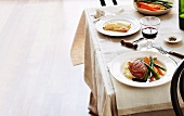 Crispy roast duck with mashed parsnip and spring vegetables and apple tart