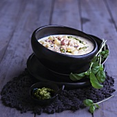 Wintry potato soup with pesto and diced bacon