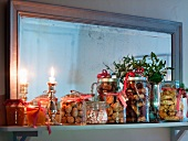 Various Christmas biscuits, jams, nuts and sweets on a shelf