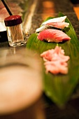 Sushi on a banana leaf in a restaurant (Japan)