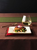 Grilled fish with vegetables and a glass of white wine