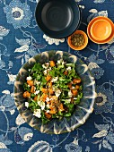 A mixed leaf salad with pumpkin and feta cheese