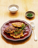 Latkas with herbs and sour cream