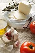 Mozzarella, garlic, tomatoes, olive oil and dried oregano