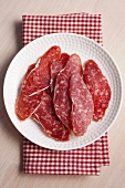 Slices of fuet salami
