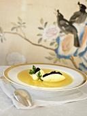 Semolina dumpling soup with caviar