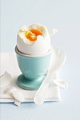 A soft-boiled egg in an egg cup