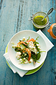 Cauliflower salad with prawns and a jar of pesto