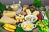 A cheese buffet with fruit and vegetables