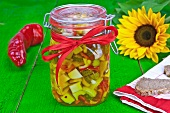 Swiss cheese pickled with vegetables and spiced olive oil